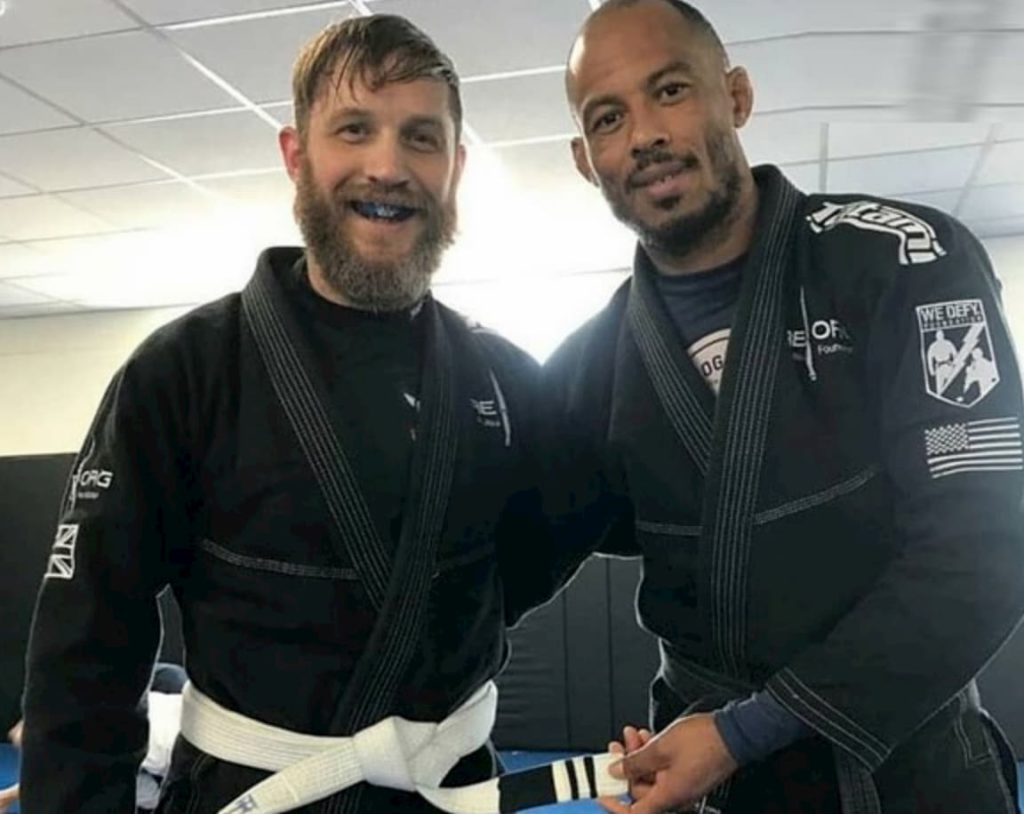 Tom Hardy getting his second stripe on his BJJ white belt