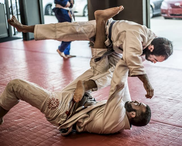 Two men practicing BJJ