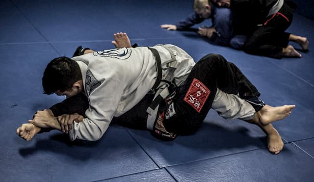 Jiu Jitsu student performing a shoulder lock