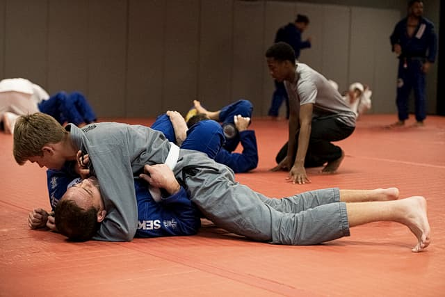 Two people practicing Jiu Jitsu