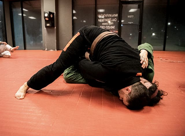 Two people rolling BJJ