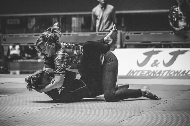 Two women doing Jiu Jitsu